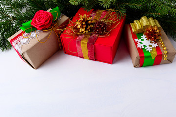 Christmas background with decorated gift boxes and Christmas tre