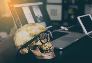 Dead Skull Business man on office table.