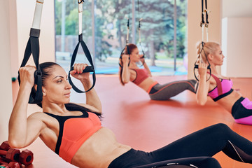 women exercise abdominal press