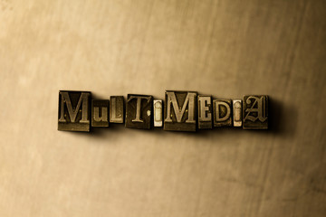 MULTIMEDIA - close-up of grungy vintage typeset word on metal backdrop. Royalty free stock illustration.  Can be used for online banner ads and direct mail.