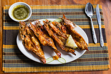 Grilled tiger prawns in a plate, close up