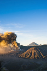 Mount Bromo volcano erupting at sunrise, sending volcanic ash high into the sky, East Java, Indonesia, Southeast Asia, Asia