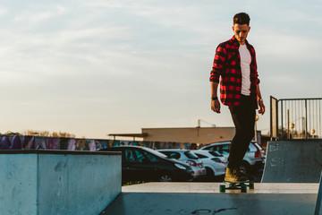 Man riding longboard on ramp