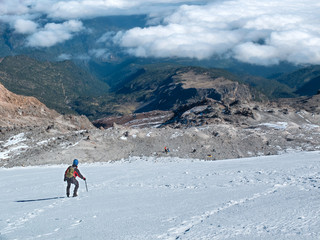 Hiker descending Mexico's highest mountain, Pico de Orizaba, that stands at  5,636 m (18,491 ft)