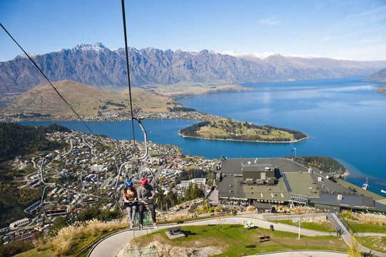 Two tourists on the gondola to the luge track above Queenstown, Otago, South Island, New Zealand