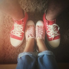 Retro snap of girl and boy wearing sneakers