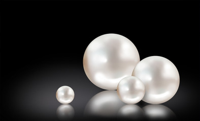 Four white pearls on black background