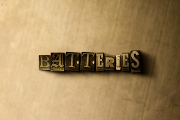 BATTERIES - close-up of grungy vintage typeset word on metal backdrop. Royalty free stock illustration.  Can be used for online banner ads and direct mail.