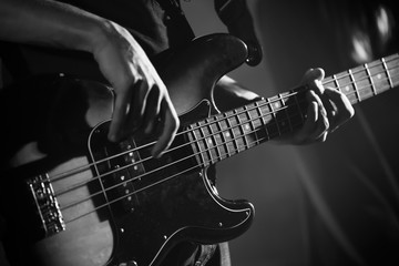 Close up photo of bass guitar player