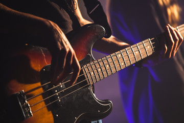 Close-up photo, bass guitar player