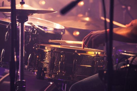 Drummer plays on drum set, vintage