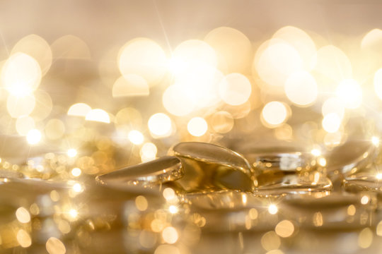 White gold - bright gold background with beads and sequins