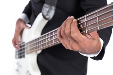 close-up of hands playing a Bass Guitar on white background