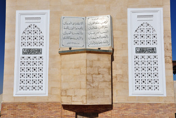 The wall of the mosque. Window and picture books
