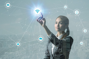 double exposure of a young woman looking at futuristic graphical user interface of IoT