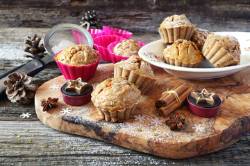 Spiced Carrot muffins, candles and pine cones