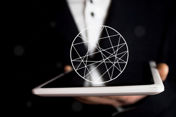 tablet and round on businessman hand