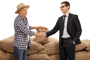Farmer and a businessman shaking hands