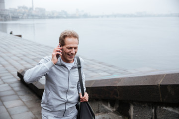 Runner talking at phone and walking on stairs