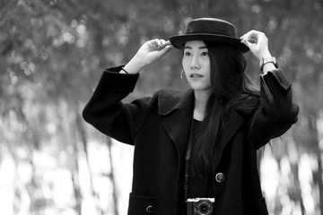 Asian girl in winter. Black And white Vintage Picture.