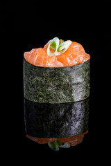Gunkan maki sushi with salmon isolated on black background