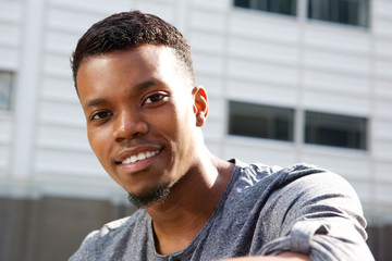 attractive young african man smiling outside