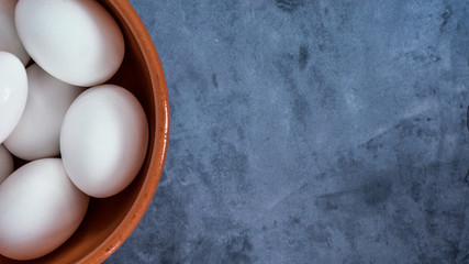 top view of eggs in bowl with copy space for text