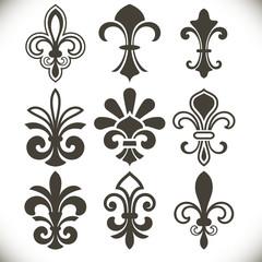Black fleur de lis shapes vector set