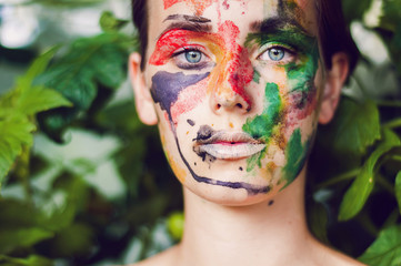woman with colorful painted face