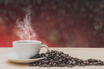 Keuken foto achterwand Cafe Coffee on wooden table with foliage bokeh background