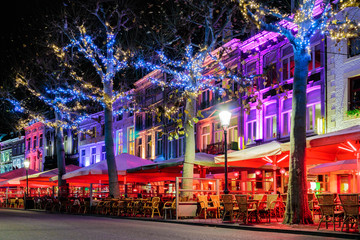 Bars and restaurants with christmas lights on the famous Vrijthof square in Maastricht