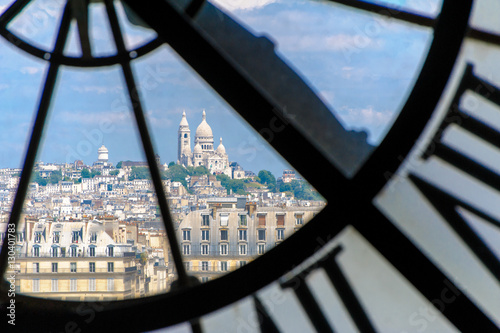 Fototapete View through d'orsay clock tower in Paris, France