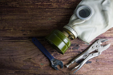 Gas mask on wooden background with copy space.