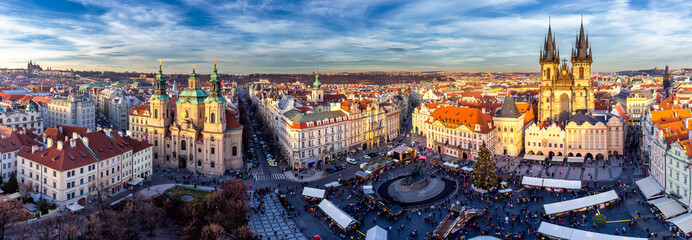 Panorama of Old Town square (czech: Staromestske namesti) during Christmas market with Castle, Church of our Lady Tyn, St. Nicholas church, Prague, Czech Republic. High resolution image.