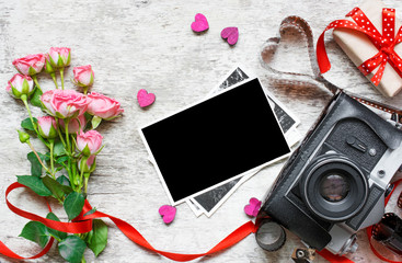 retro camera with blank photo, roses and gift box. valentines day