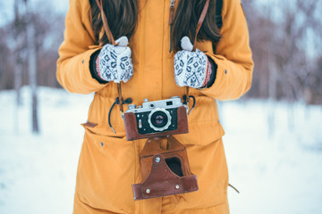 Stylish woman photographer with retro camera