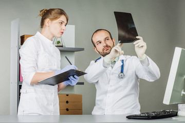 Medical doctors analysing x-ray print