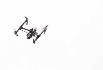 Aerial drone shooting aerial footage and aerial images while flying