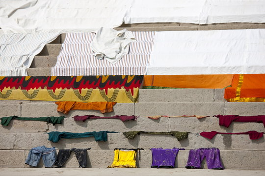 Laundry on the steps of the Ghats by The Ganges River at Kali Ghat in City of Varanasi, Benares