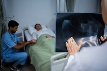 Doctor analyzing x-ray in ward