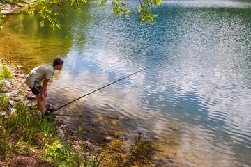 Teenager fishing at the lake