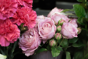 Spring Flowers in a flower shop. Street flower market. Different roses.