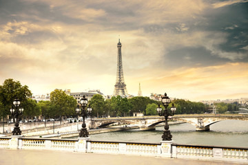The Eiffel Tower and Pont Alexandre III at evening in Paris, France.