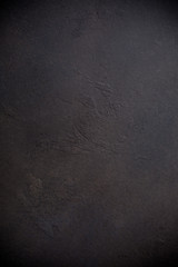 Rusty brown concrete stone background texture. Vertical.