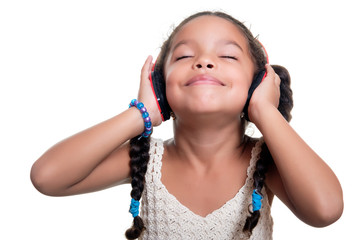 Cute african american small girl listening to music on wireless headphones