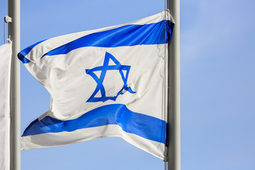 Blue and white flag of Israel on wind