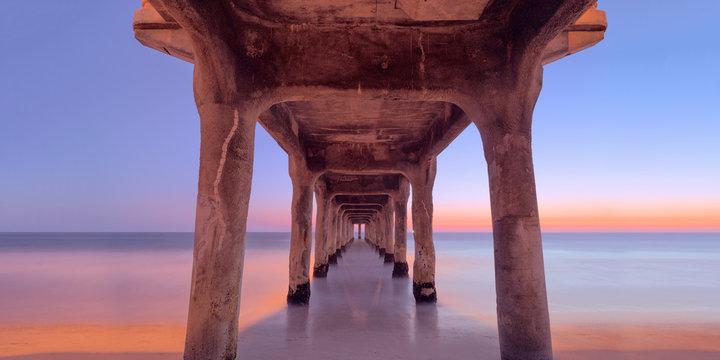 Beneath a concrete pier on, manhattan beach, california, usa.