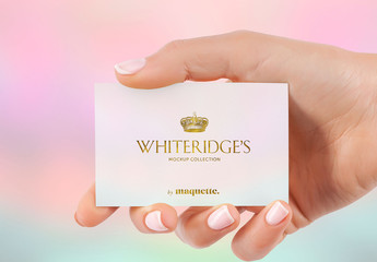 Hand with Gold-Embossed Business Card Mockup 15