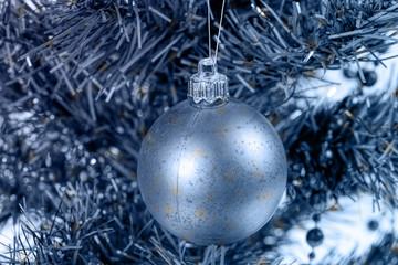 Christmas card. Balls and garland on a Christmas tree