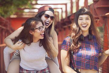Group of female teen friends having fun outdoors